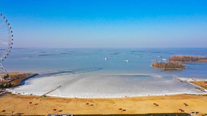 湖畔冰凌,树林沙滩……寒潮下,雷竞技官网手机版有这样的唯美世界!